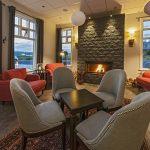 Hotel Grimsborgir in Südisland Kaminzimmer mit Sitzecke